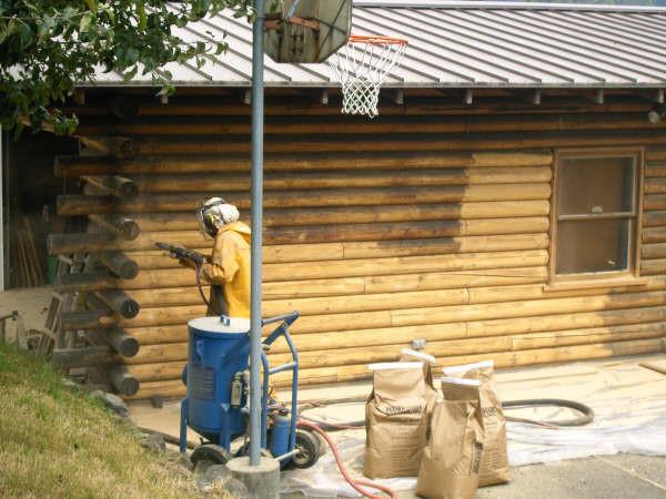 Wildwood log home restoration glass media blasting a pacific northwest log home.