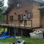 Wildwood Log Home Restoration chinking and staining on a pacific northwest log home.