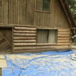 New-age glass media blasting exterior log home restoration.