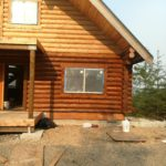 Exterior log home staining in Washington by Wildwood Log Home Restoration