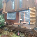 Exterior log home stain with Perma-Chink staying by Wildwood Log Home Restoration