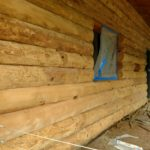 Wildwood log home restoration glass media blasting.