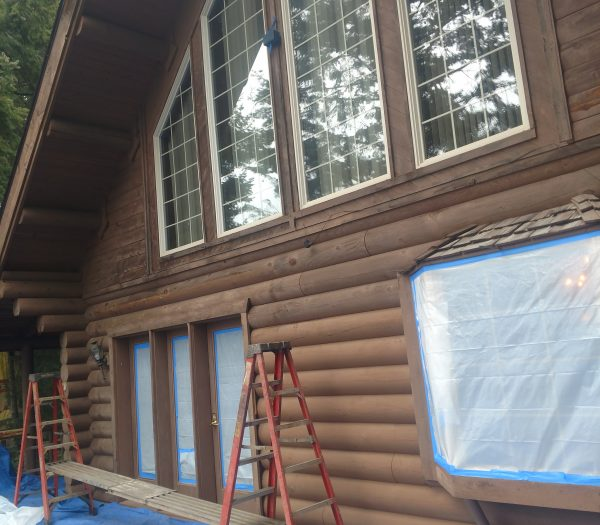 Log home in the pacific northwest needing glass blasting, chinking, and staining.