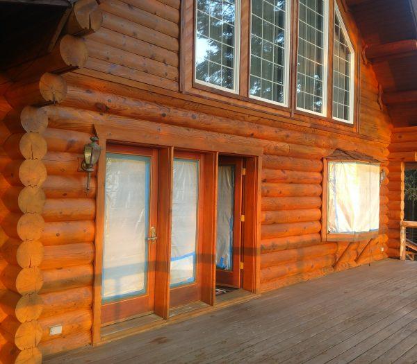 Log cabin in Washington state restored by wild wood log home restoration.